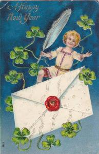 A Happy New Year, Shamrocks, sealed envelope and boy holding exagerated quill...