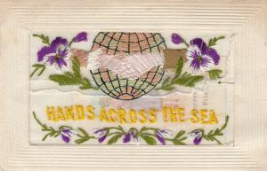 Embroidered Globe & Hands, Hands Across the Sea, 00-10s; Insert Sincere Friend