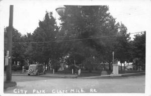 Clare Michigan~Water Tower Over City Park~Notice on Telephone Pole~1930 Car~RPPC