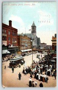 Omaha NE~16th St N~Crowds on Sidewalks~Dr Foster-Reliable Dentist~Trolley~1909