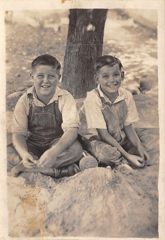 Real Photo Postcard~Classic: 2 Boys in Bib Overalls~Cross-Legged Under Tree~1925