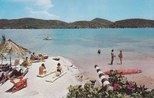 Enjoying white sand and clear waters at Carib Beach Hotel, St. Thomas, U.S. V...