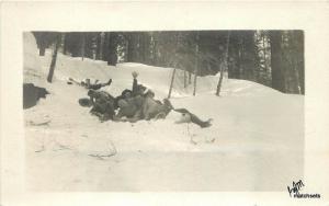 C-1910 Fun snow Action Group photo RPPC postcard 16-142