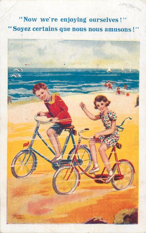 now we`re enjoying ourselves children couple bicycles seaside beach artist pc