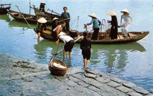 South Vietnamese women unloading boats DA NANG Vietnam c1950s Vintage Postcard