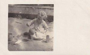 RP: Little GIrl playing in sandbox, 1910-20s