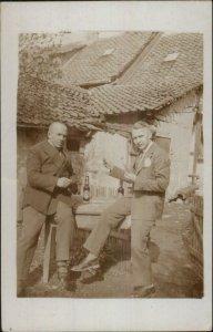 Men Playing Cards Drinking Beer Visible Bottles c1910 Real Photo Postcard