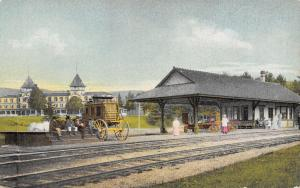North Woodstock~Stage Coach Parked at the RR Station~Men on Steps~Hotel c1910