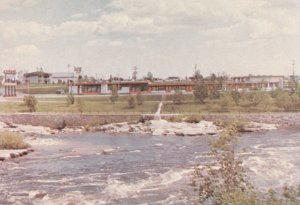 MISTASSINI, Quebec, PU-1989; Motel Chutes Des Peres Inc. from across the Water