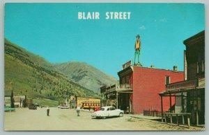 Silverton Colorado~Blair Street~False Front Buildings~Cowboy Billboard~Car~1960s