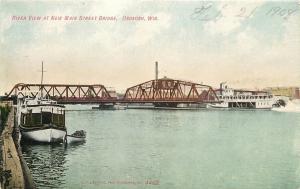 Oshkosh Wisconsin~River View~New Main Street Bridge~Boats at Pier~1908 Postcard