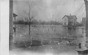 Michigan~Kalamazoo River Flood~Houses~People in Boat~Bare Trees~c1910 RPPC
