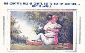 Romantic Couple Kissing While Playing Tennis