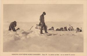 Catholic Missionaries Carrying Fish Back to Camp on Dogsled, Northwest Territ...
