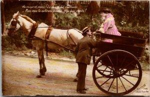 RISQUE POSTCARD WWI RPPC FRANCE YOUNG LADY & MAN ROMANCE WAGON