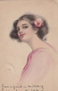 Portrait of brunette woman with pink rose in her hair. PU-1914