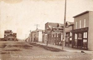 Lamoure ND~Front Street~CA Finch Lumber & Fuel~Theo Magnus Clothing~1910 RPPC