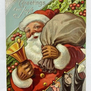 c.1915 Old Santa Claus Bell Toys Sack Bag Stockings Embossed Christmas Postcard