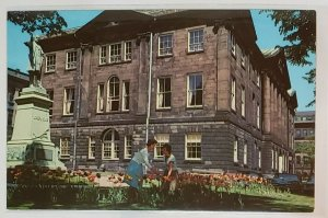 Vintage Postcard: Nova Scotia, CAN- Province House. Woman picking flowers.