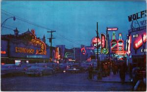 JUAREZ, CHIH. MEXICO  STREET SCENE at Nite Lots of NEON  50s Cars Roadside