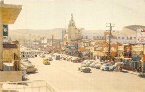 F55/ Tijuana Mexico Foreign RPPC?Postcard 40s Main St Curio Shops Autos