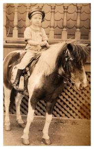 Young boy on Pony , U.S.Navy hat ,  , RPC