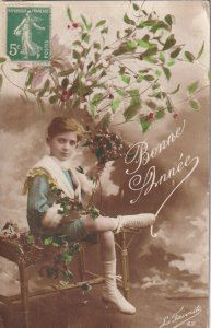 RP: NEW YEAR, PU-1917; sailor Boy sitting on bench holding bouquet of flowers