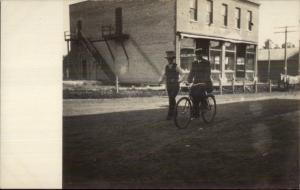 Kerkhoven MN Written on Back - Men in Street & Bldg c1910 Real Photo Postcard