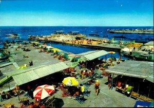 CI01340 lebanon beirut beach modern beach umbrellas mediteraneean sea