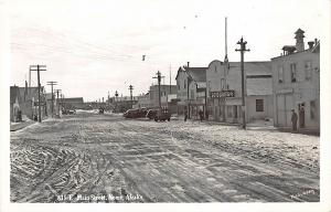 Nome AK Dirt Main Street Store Fronts North Pole Bakery  RPPC Postcard