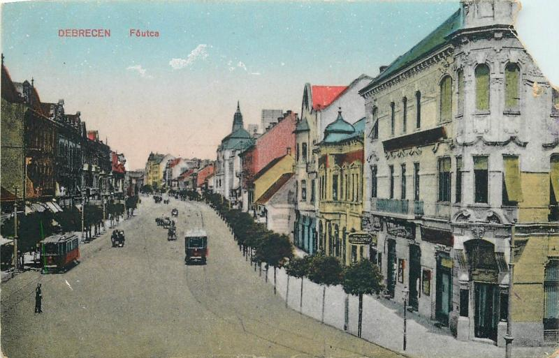 Hungary Debrecen Foutca tramway trams stores street upper right corner damaged