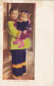 The Young Chinese Mother With Child