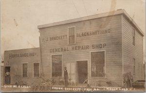 Troy MO Frank Brackett Wagon Shop Blacksmith with White Dog RPPC Postcard E64