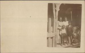 Black Americana - Boys & Women on Porch c1910 Real Photo Postcard dcn