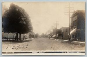 New Hartford Iowa~Main Street~Palace~Railroad Crossing~Elevator~1909 RPPC