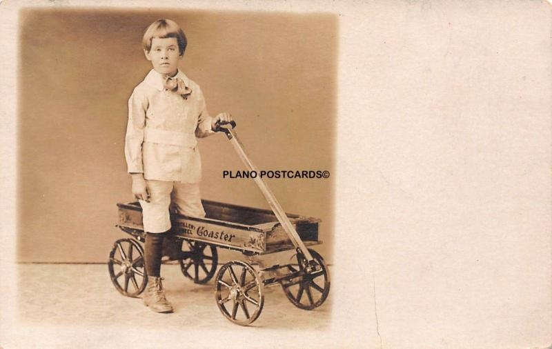 EARLY 1900'S CHILD WITH VINTAGE COASTER WAGON RPPC REAL PHOTO POSTCARD