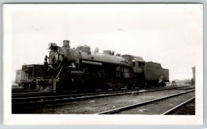 Chicago Photograph:Engineer Examines Front End of Baltimore & Ohio Train #5206