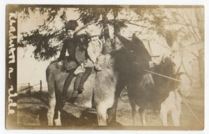 111920 VINTAGE RPPC REAL PHOTO POSTCARD 3 CHILDREN ATOP A DONKEY READY FOR RIDE