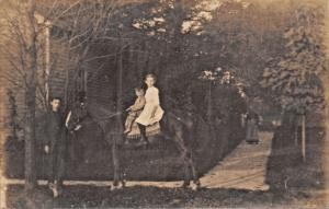 CHILDREN SITTING ON HORSE-REAL PHOTO POSTCARD 1910s