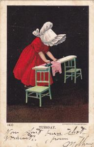 Tuesday, PU-1906; Girl ironing on a board held by two chairs