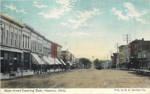 Stanton Michigan~Main Street East~Awnings on Storefront~Wide Dirt Road~1914 PC