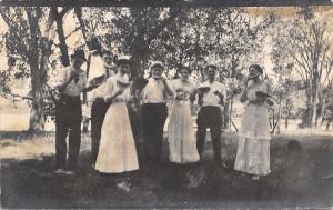 Folks in Picnic Grove Eat Watermelon~Girls in White~4 Men~Real Photo~1915 RPPC