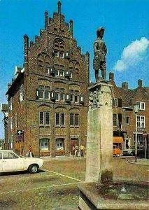 Netherlands Holland Venlo Roemerhuis met Schinke Manneke Statue Auto Cars