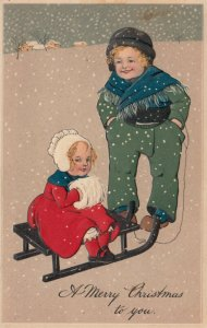 CHRISTMAS, 1900-10s; girl with hand muff sitting on sled in snow fall, PFB 6211
