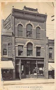 R. E. Pudney's Piano & Music Store RPPC Postcard