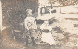 DR1/ Interesting RPPC Postcard c1910 Children Wagon Walker Smile