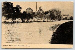 Postville Iowa~Buildings Along Turkey River Bluffs~Town Shoreline~c1910 B&W PC