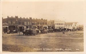 Canby Minnesota~Front Street~Restaurant~Loaded Down Wagons~Dog~c1912 RPPC
