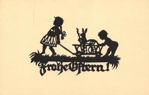 Silhouette Frohe Ostern! Easter children girl carrying bunny rabbit cart