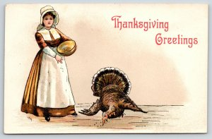 HBG Griggs Thanksgiving~Pretty Pilgrim Lady Dishes Out Turkey Feed~Embossed~1911